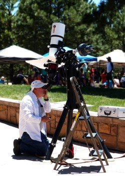 Volunteer looks through solar telescope