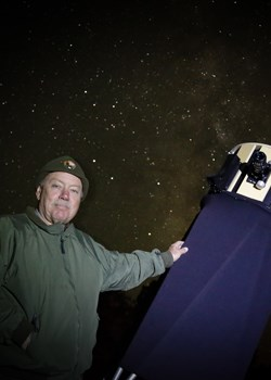 Ranger Ben Benson with Telescope night sky
