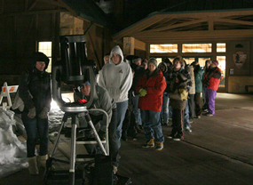 Winter visitors waiting for the telescope at Visitor Center.