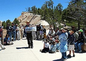 Park Ranger describing geological features to an audience of visitors to Bryce Canyon