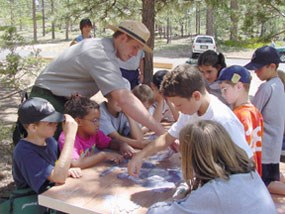 Park Ranger interacting with children during an interpretive program