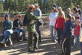 Park Ranger interacting with visitors during an Interpretive progam along the rim of Bryce Canyon