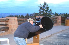 Visitor using Telescope during night sky program