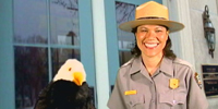 Ranger Rachel and Allen the Eagle in front of Brown v. Board of Education National Historic Site.