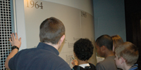Students search the timeline for answers to the scavenger hunt.