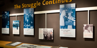 An image of The Struggle Continues Exhibit featuring images from the Civil Rights Movement.