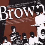 Cover of Brown teacher's guide with image of young student standing up to read to her teacher.