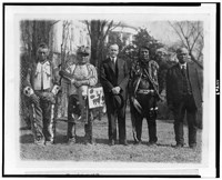 President Calvin Coolidge posed with Native Americans, possibly from the Plateau area in the Northwestern United States, near the south lawn of the White House. Photo, 1925.
