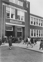 Image of students running towards the entrance of the Buchanan School, date unkown.