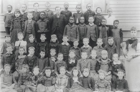 Image of fourth grade students, both black and white, at Lowman Hill School in 1892.