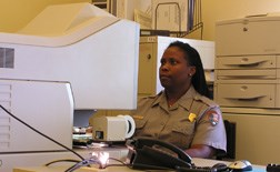 Park Ranger Nichole McHenry researches information on microfilm in the research library.