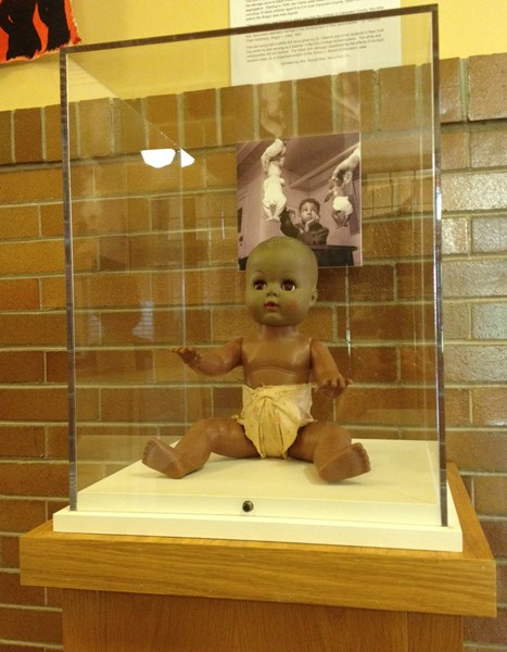 Black baby doll with diaper from kenneth and Mamie Clark's studies.
