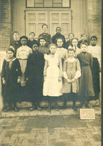 Image of sixth grade students, both black and white, at Grant School in the early 1900's.