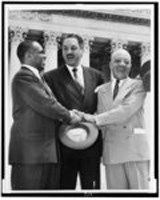 George E.C. Hayes, Thurgood Marshall, and James M. Nabrit, congratulating each other, following Supreme Court decision declaring segregation unconstitutional. Photo, May 17, 1954.