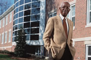 Dr. John Hope Franklin in front of the building at Duke university that bears his name.