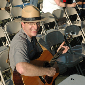 New Nicodemus acting superintendent Dave Schafer playing banjo in the Flint Hills