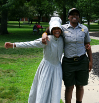 Ranger Christina LaSane and friend meeting with living history actors in Lawrence, Kansas.