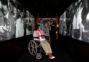 Little Rock nine members watch themselves in historical news footage.