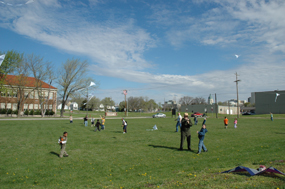 Students flying kites on the historic playground.