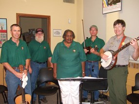 Ron Parker, Norton Canfield, Willie Faye Smith, Ken Ruhnke, and Dave Schafer provide music of the parks at the artwalk.