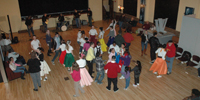 Visitors dance to music from the 1950s and 1960s during the first community sock hop.