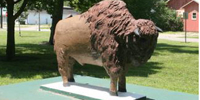 A bison monument from the former Kansas Vocational School located in Cushinberry Park.