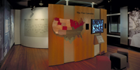 The Five Lawsuits exhibit and timeline wall panels in the Education and Justice gallery.