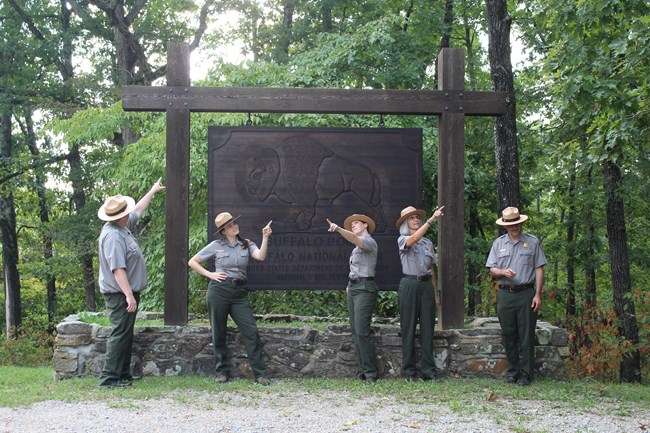 5 park rangers comically point in different directions