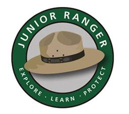 "color photo of Junior Ranger ""Explore, Learn, Protect"" logo"
