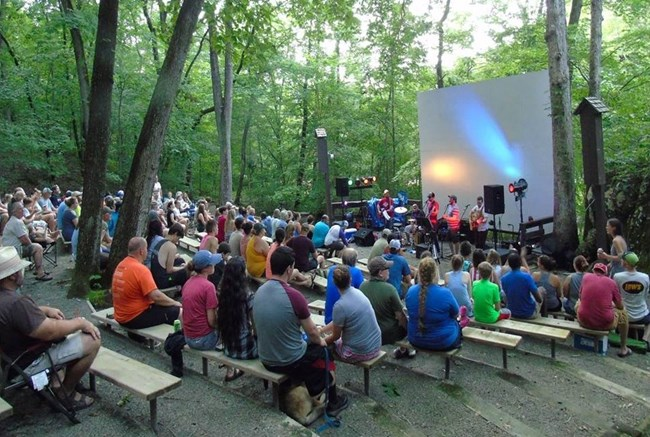 Campers enjoying a band at the Buffalo Point Amphitheater
