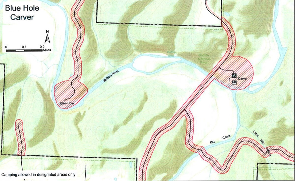 topographic map of Carver access area and Blue Hole area, safety zone no hunting area shaded red, roads solid balck lines, Caver campground and boat launch marked at center right, mileage and compass direction at top left