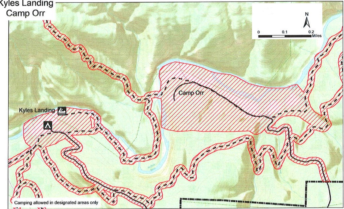 topographic map of Kyles and Camp Orr areas, no hunting safety zones shaded red, roads solid black lines, trails dashed black lines, boundary dash dot dash black line,  mileage and compass direction at top right