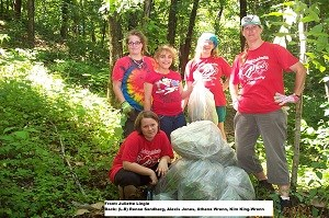 4 Girl Scouts and leader remove garlic mustard along trail