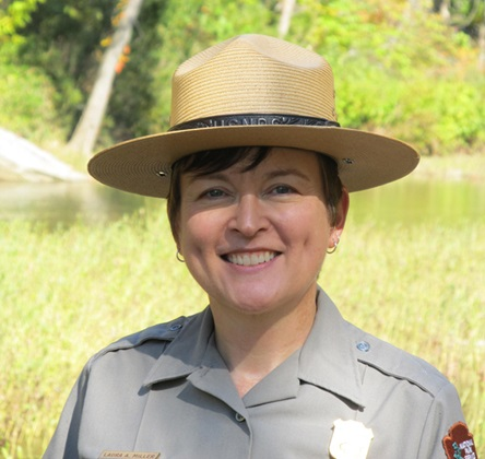 Portrait of Superintendent Laura Miller outdoors in a National Park Service uniform.