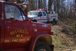 Rea Valley red fire truck at left, white NPS fire vehicle in background at center