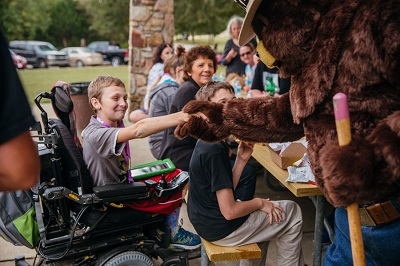 Smokey Bear shakes hands with Special Olympian