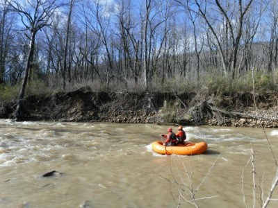 Experienced whitewater paddlers approach a standing wave