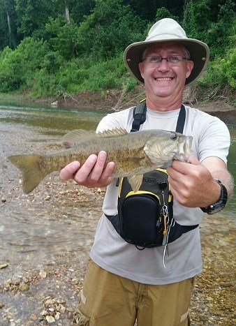 Man holding a smallmouth bass