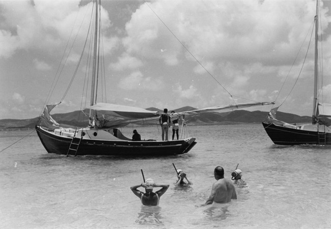1960s black and white photo of snorkelers and sailboats at Buck Island