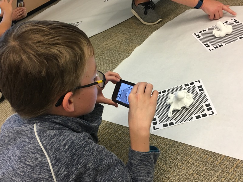 a student uses an iPod to capture images of his model from every angle, the first step in creating a ready-to-print 3D biomodel.