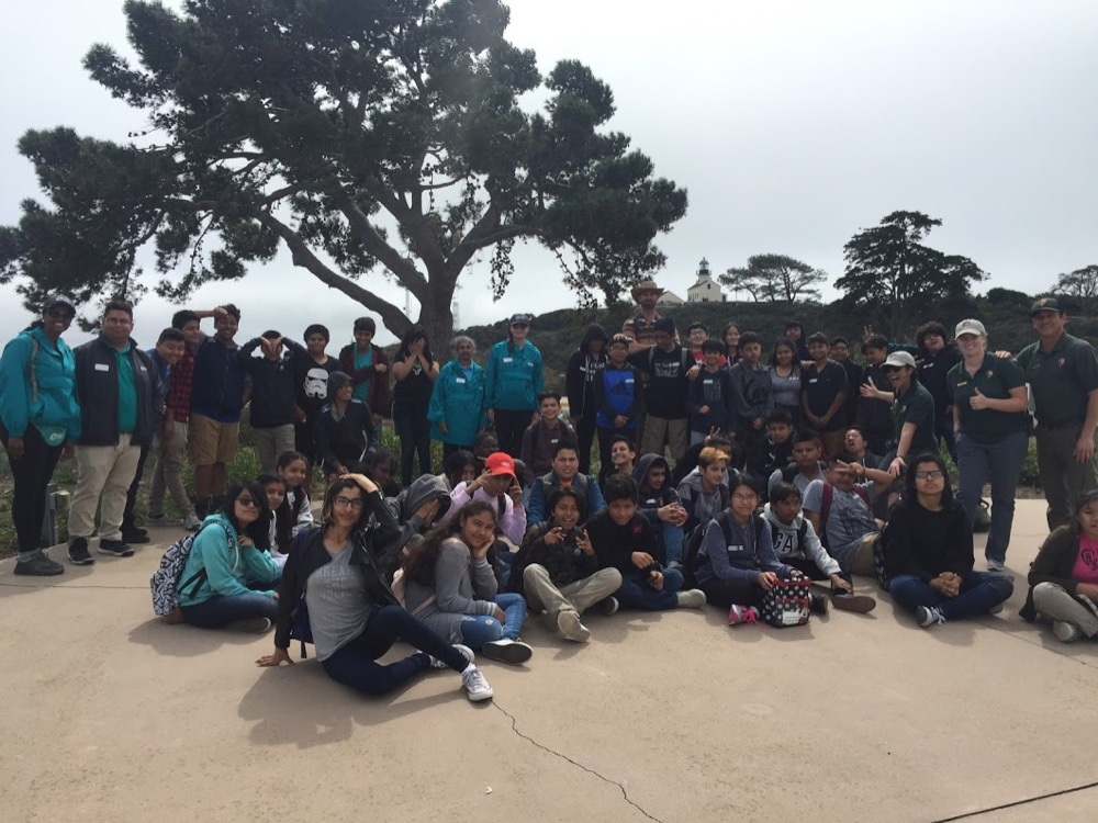 A group of people, including the Cabrillo Science Education team, Ocean Discovery Institute staff, and a 7th grade class at Cabrillo National Monument.