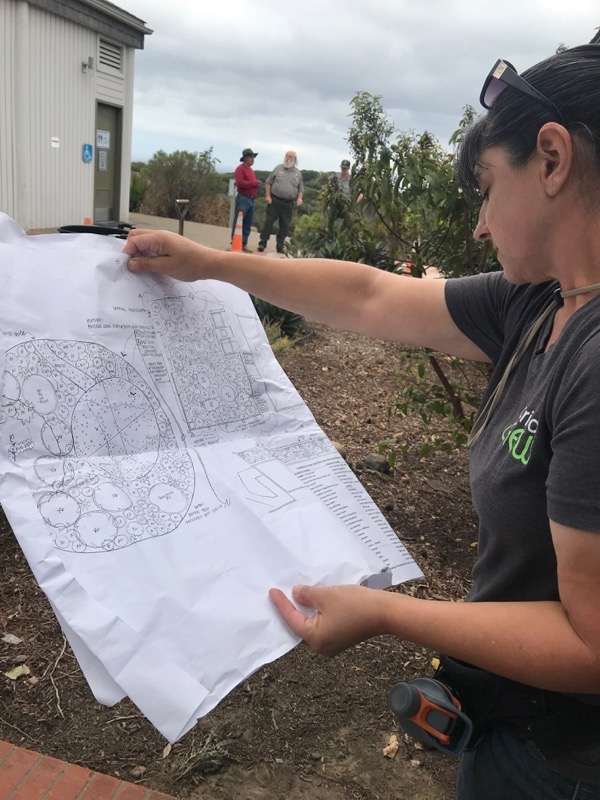 VIP Patricia Simpson reviews the landscape plans for where to put her next plant.