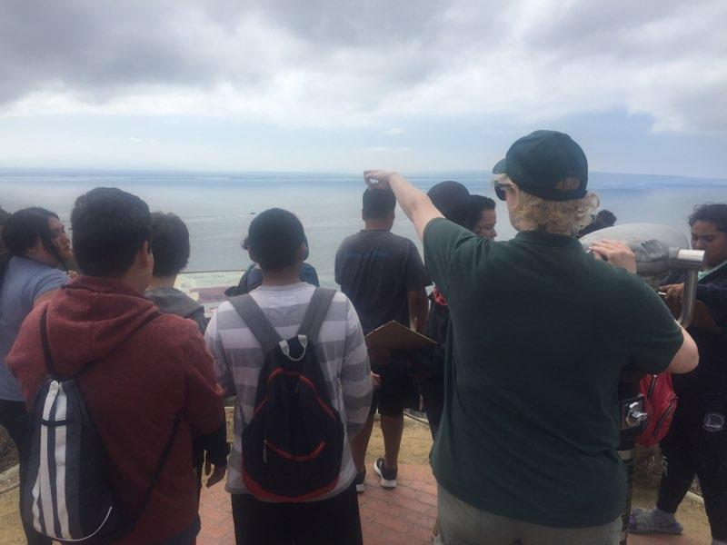 Students from Monarch School observing biodiversity on a nature walk at Cabrillo National Monument