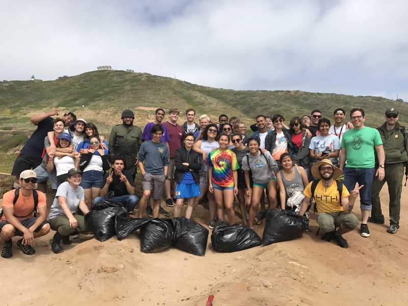 Group photo of students who helped remove sargassum
