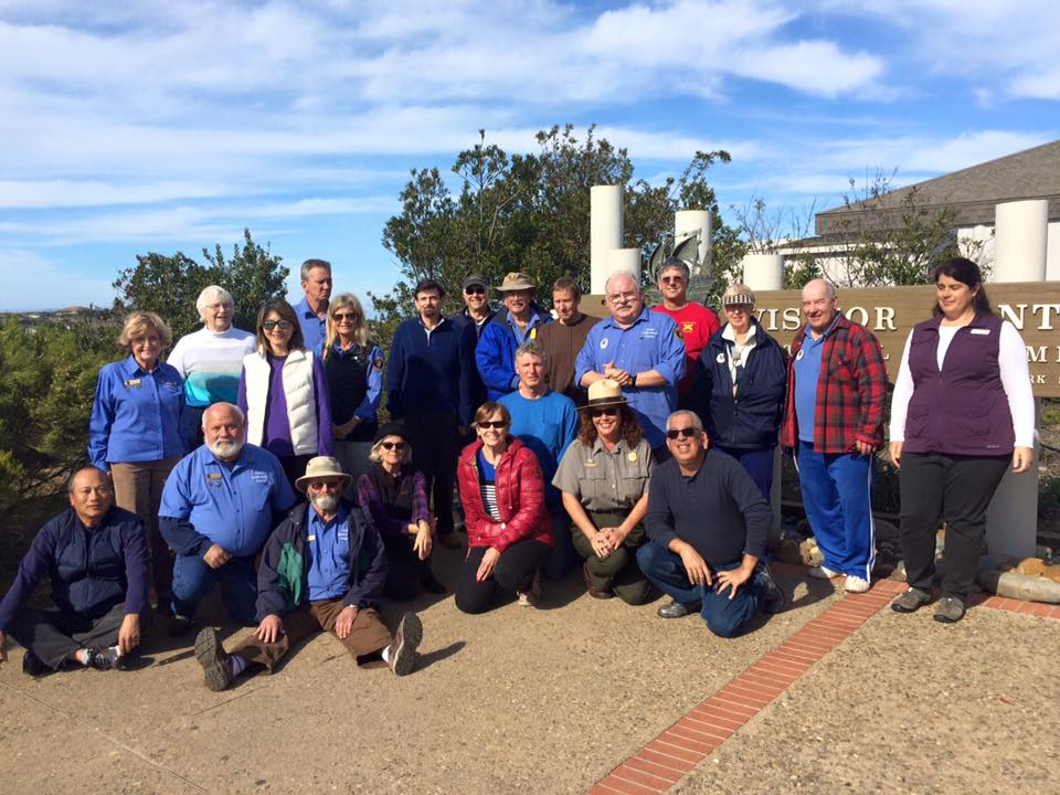 a group of people smiling for the camera near the Visitor Center at Cabrillo National Monument.