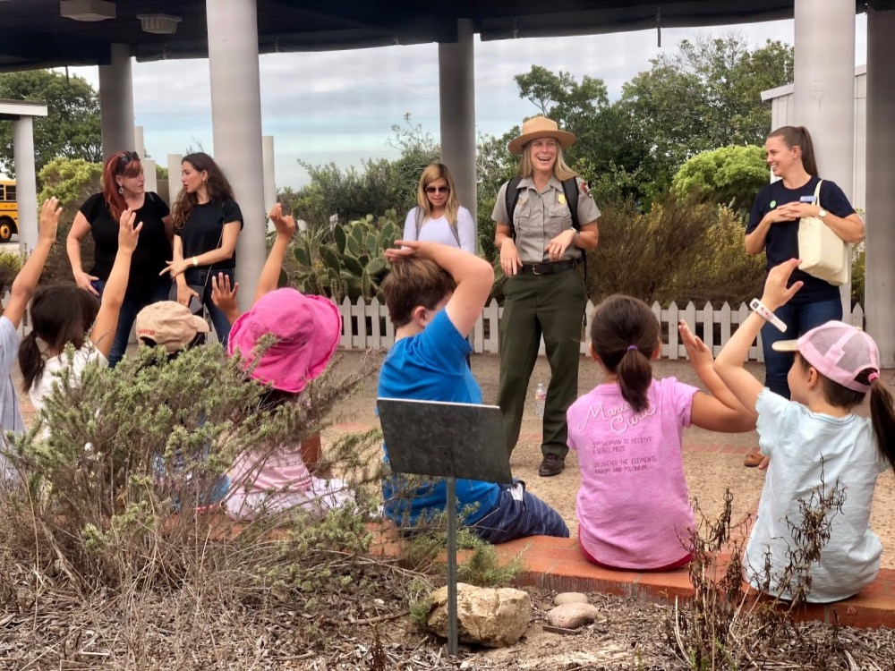 A Park Ranger presenting to a group of fourth-grade students at Cabrillo National Monument.