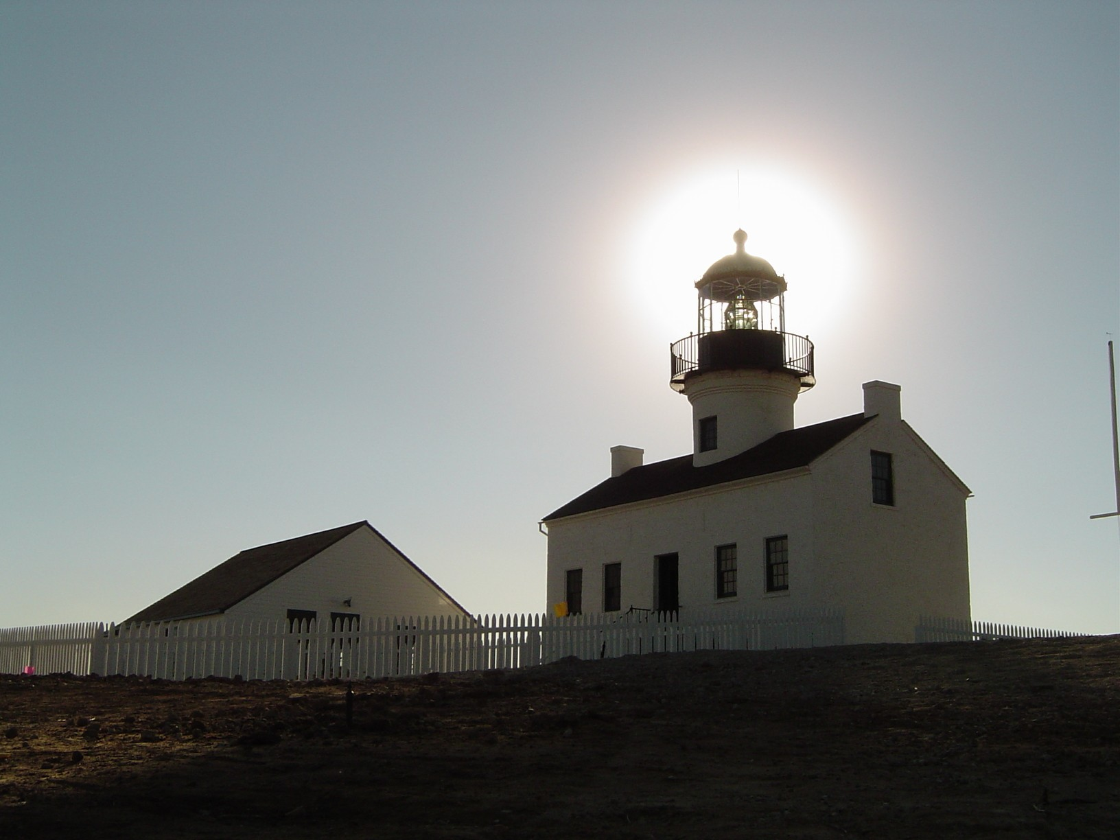Old Point Loma Lighthouse with sun behind