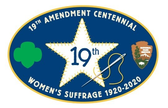 "Navy patch with Girl Scout logo and National Park Service arrowhead on either side of a white star with ""19th"" written in the middle. Text ""19th Amendment Centennial / Women's Suffrage 1920 - 2020"" surrounds images on top and bottom of patch."