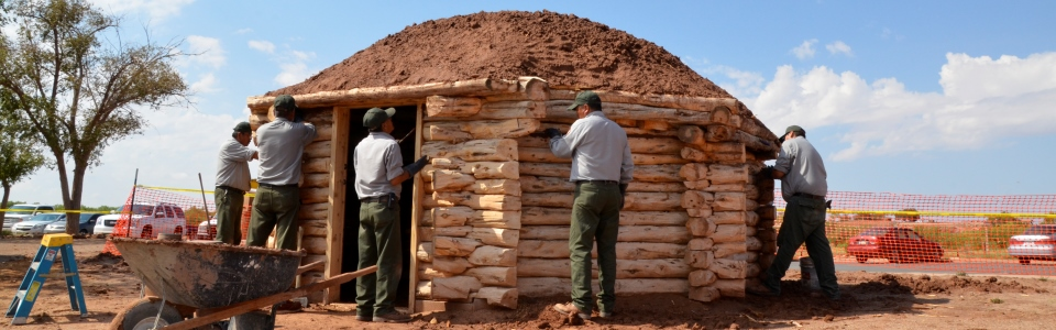 NPS Staff working on traditional Navajo home