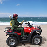 scientist on an ATV along a beachfront